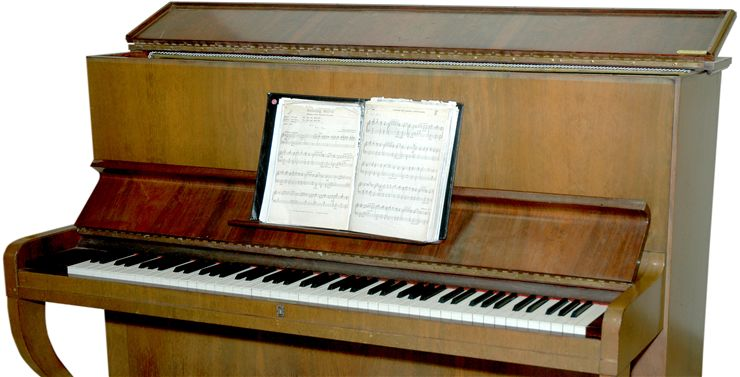 Old Piano and Sheet Music